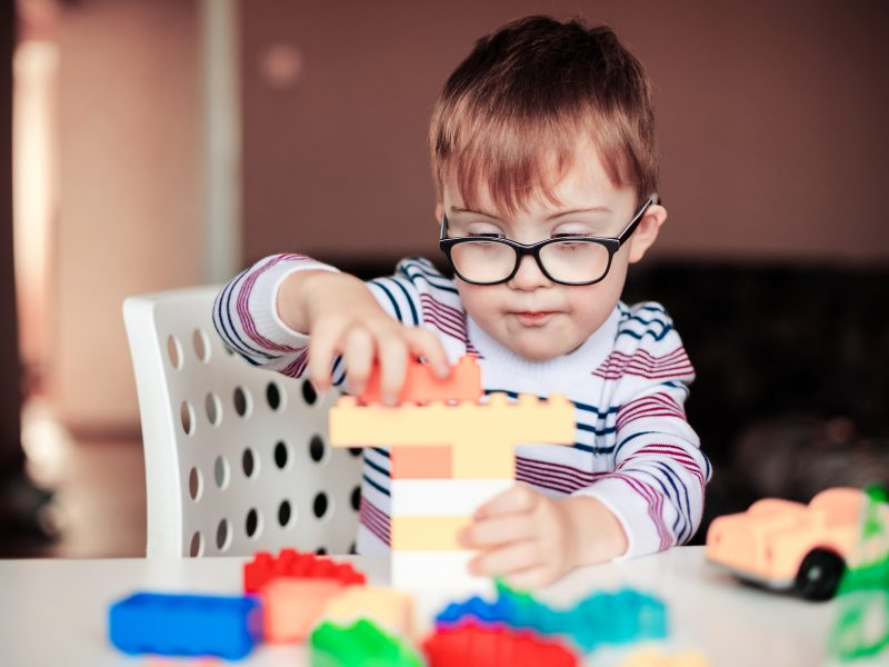 A child with special needs playing