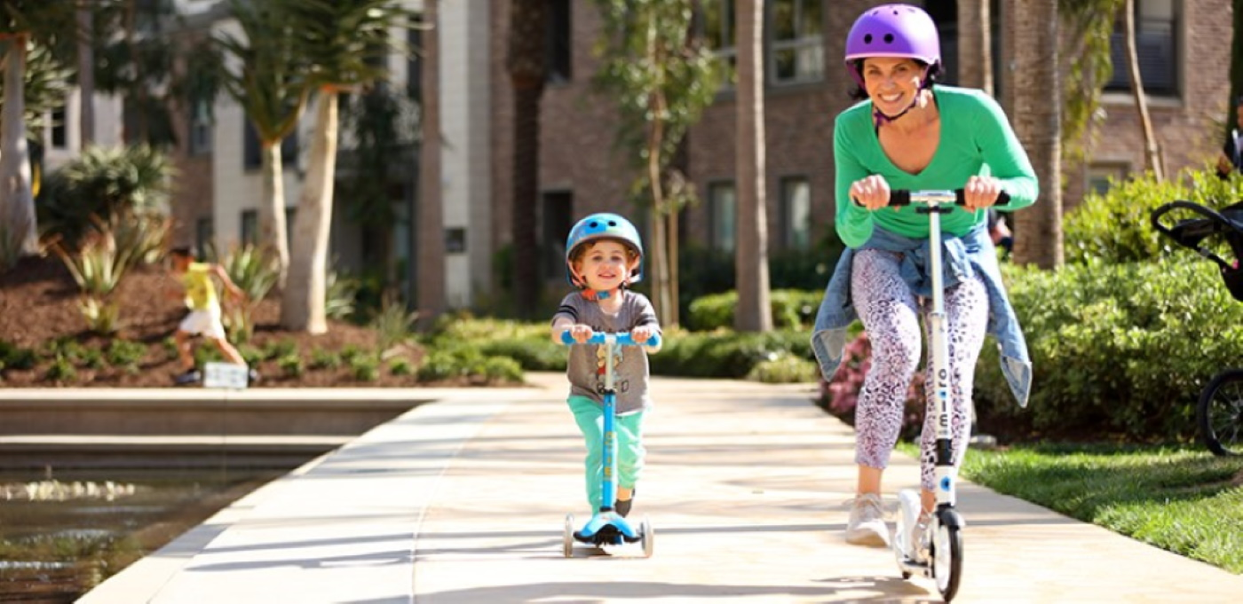 Mum with ADHD scooting with childn